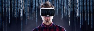 Hipster man in checked shirt wearing virtual reality goggles. Studio shot on black background